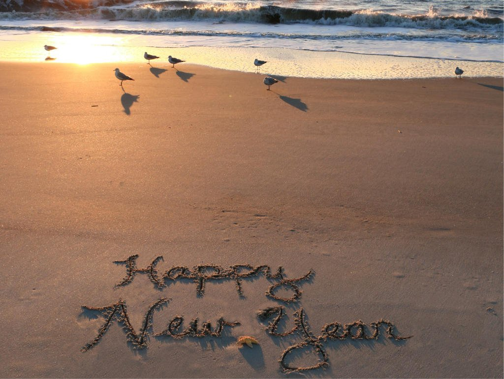 Happy New Year written in sand